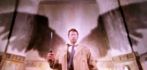 Castiel showing wings and glowing