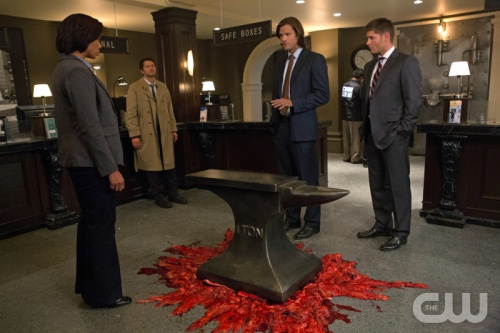 Sam, Dean, and Cas stare at something crushed under an anvil