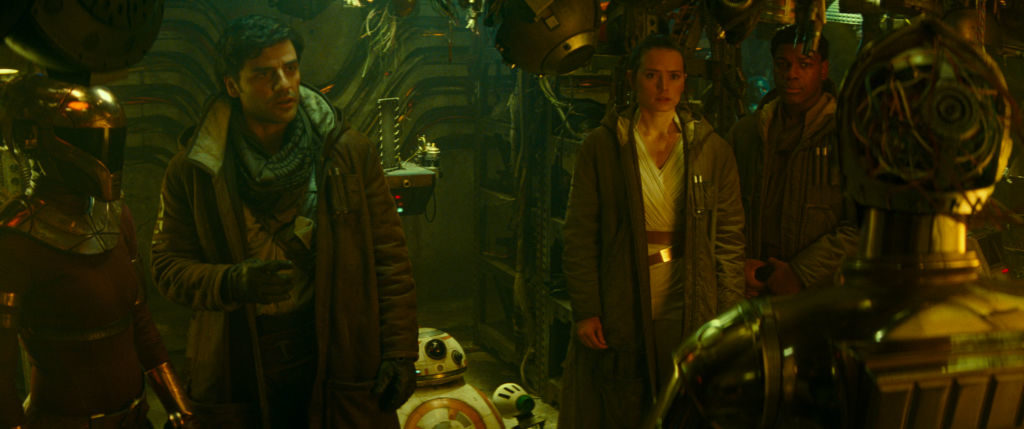 Oscar Isaac is Poe Dameron, Daisy Ridley is Rey and Anthony Daniels is C-3PO in STAR WARS: THE RISE OF SKYWALKER